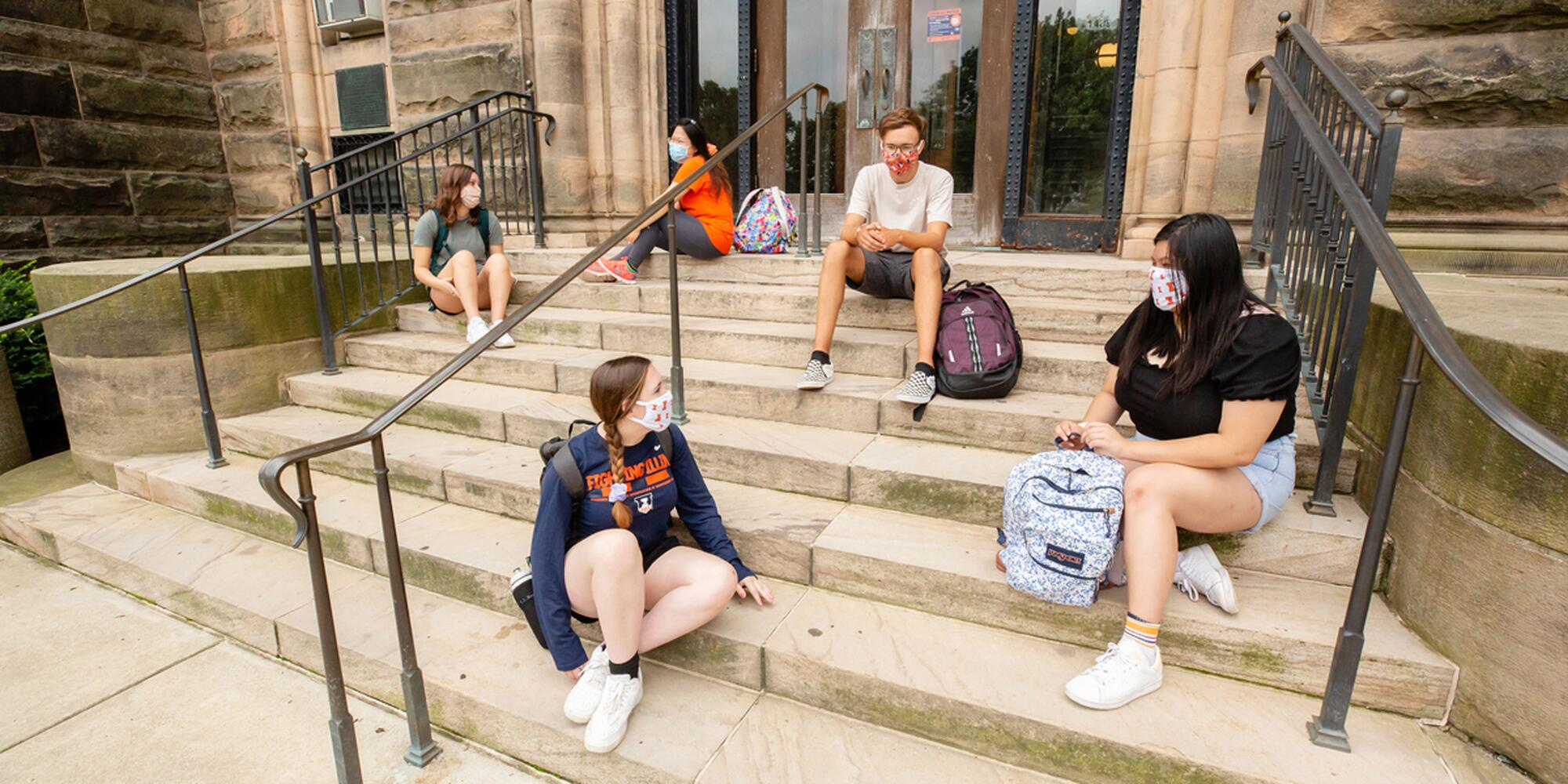 photo of students sitting on steps